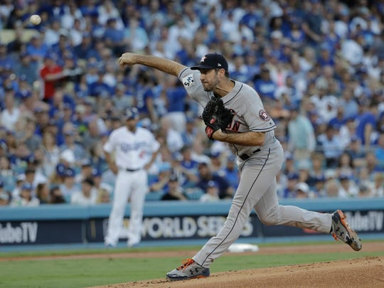 Houston Astros starting pitcher Justin Verlander throws during the first inning of Game 2 of baseball's World Series against the Los Angeles Dodgers Wednesday, Oct. 25, 2017, in Los Angeles. (AP Photo/David J. Phillip)