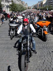 Riders make their way through Wenceslas Square in the heart of Prague on Saturday during the motorcycle parade that is part of Harley's 115th anniversary celebration.