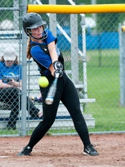 Harper Creek's Jacqueline Greene swings at a pitch