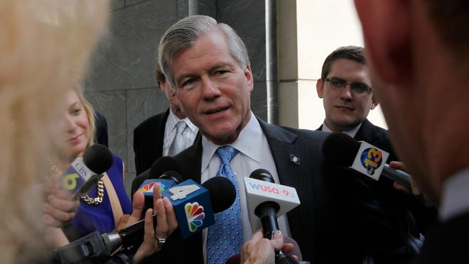 Former Virginia Gov. Bob McDonnell talks with reporters outside the federal courthouse in Richmond, Va., Wednesday, Aug. 20, 2014, as the federal corruption trial against him and former first lady Maureen McDonnell continues into the fourth week. (AP Photo/Richmond Times-Dispatch, Bob Brown). ORG XMIT: VARIT103