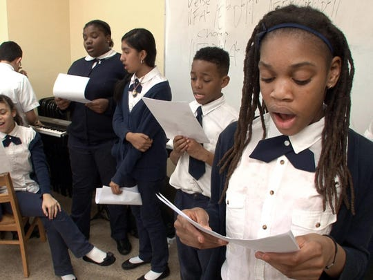 Dourna Moise, 11, sings with other Hope Academy of Asbury Park students Wednesday, March 16, 2016. The program is part of an Asbury Park Music Foundation initiaitve to bring music education into school.