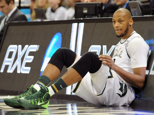 SPOKANE, WA - MARCH 20:  Adreian Payne #5 of the Michigan State Spartans waits to come back into their game against the Delaware Fightin Blue Hens in the second round of the 2014 NCAA Men's Basketball Tournament at Spokane Veterans Memorial Arena on March 20, 2014 in Spokane, Washington.  (Photo by Steve Dykes/Getty Images)