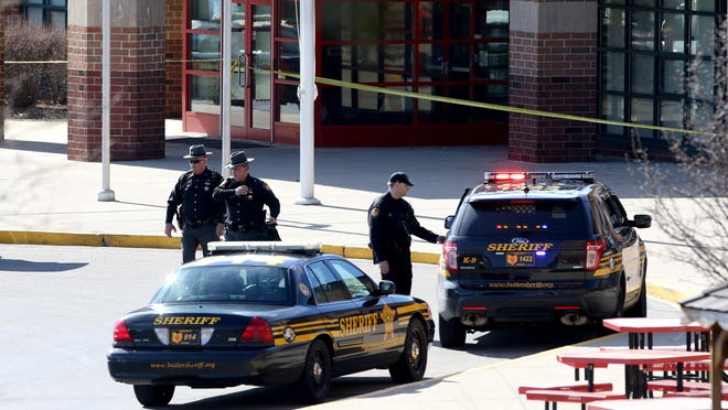 Members of the Butler County Sheriff's Department remained on the scene Monday afternoon following a shooting at Madison Jr./Sr. High School.