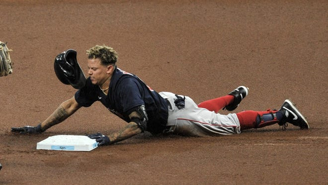 The Red Sox' Yairo Munoz slides into second base with a double off Rays starter Charlie Morton in the first inning of Sunday's game in St. Petersburg, Fla. Munoz scored on a home run by Christian Vázquez.