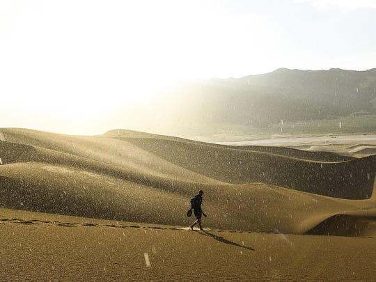 Rain begins to fall on the Great Sand Dunes National