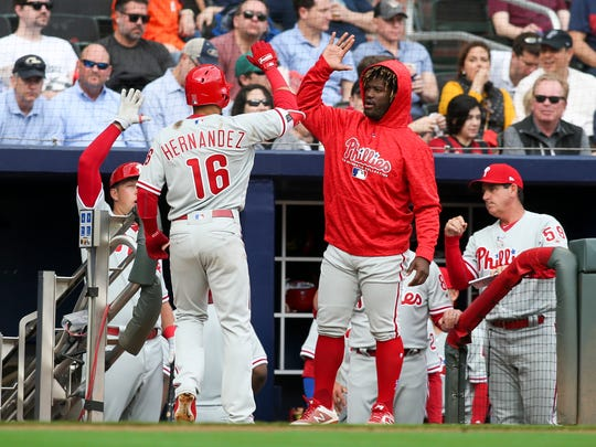 Phillies second baseman Cesar Hernandez (16) celebrates with center fielder Odubel Herrera (37) after a home run against the Atlanta Braves in the sixth inning at SunTrust Park on Thursday, March 29, 2018, in Atlanta.