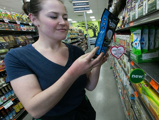 Sarah Harlow looks over food labels at Mountain View