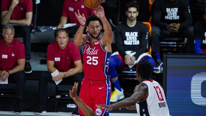 The Sixers' Ben Simmons shoots over the Wizards' Thomas Bryant.  [AP Photo]