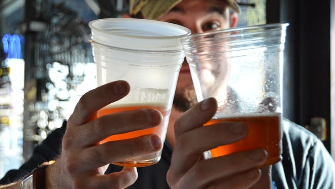 Mike Lee, an Ocean City local, cheers a friend at the Dewey Brewfest.