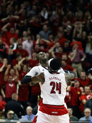 Louisville's Montrezl Harrell (#24) and Mangok Mathiang celebrate after Mathiang made the game winning shot.  March 7, 2015