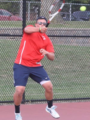 Franklin No. 1 singles player Lukas Pekorius returns a serve during Tuesday's match against Canton.