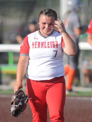 Hermleigh pitcher Morgan Kariainen walks off the field after getting the final out in the Lady Cardinals' 17-8 victory over Rotan in one-game playoff in the Region I-1A semifinals Saturday, May 12, 2018 at ACU's Wells Field. Kariainen's father passed away five days before Saturday's game.