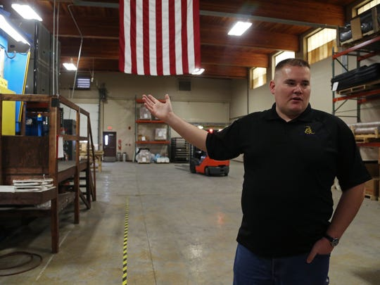 Blake Waldrop, CEO of RMA Armament, stands on the production
