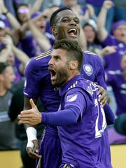 Orlando City's Cyle Larin, back, celebrates after scoring a goal against New York City FC with teammate Antonio Nocerino (23) during the first half of an MLS soccer game, Sunday, March 5, 2017, in Orlando, Fla.