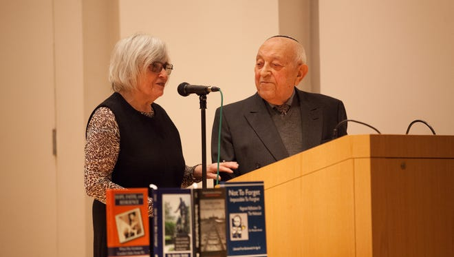 Dr. Moshe Avital and his wife Anita Avital speak to a crowd at the New Rochelle Library for Holocaust Remembrance in New Rochelle, Jan. 29, 2017.