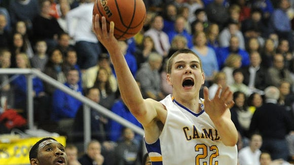 Carmel's Zach McRoberts drives to the basket for a lay up against North Central inside the Eric Clark Activity Center, Friday, December 13, 2013, at Carmel High School.