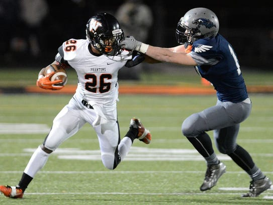 West De Pere running back Dom Conway stiff arms Appleton