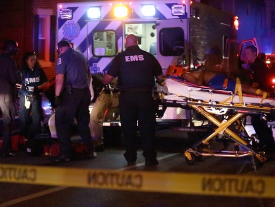 Emergency personnel treat two young people after several