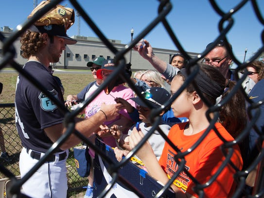 Tigers fans receive autographs from Daniel Norris at