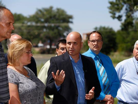 New Mexico Attorney General Hector Balderas, center,