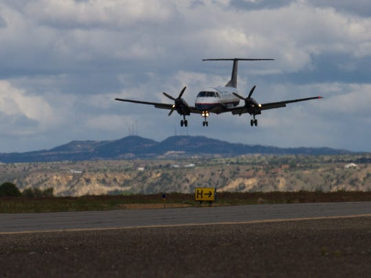 A Great Lakes Airline aircraft approaches the runway Thursday at the Four Corners Regional Airport in Farmington.