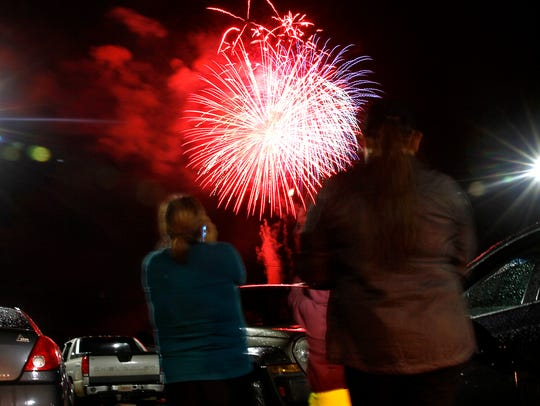 Spectators watch the annual Fourth of July Farmington