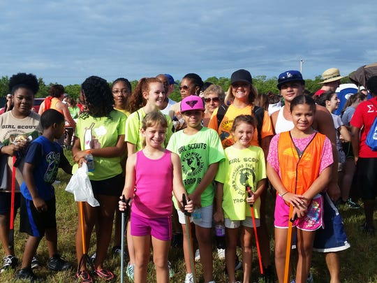 Girl Scouts from the Lehigh Acres-based Troop 746 pose for a picture during the annual coastal cleanup on Lovers Key, Saturday, Sept. 17. Patrick Riley/Staff