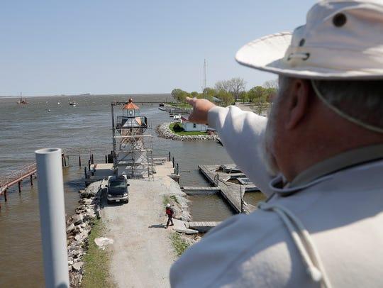 Wayne Dunbar looks toward the mouth of the Fox River