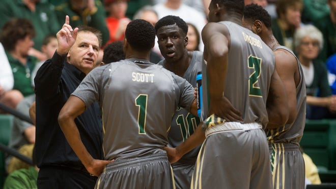 CSU coach Larry Eustachy talks to his team during a timeout in a home game late last season. CBS-Sports Network selected seven CSU games for national broadcasts in 2016-17, and Root Sports will televise seven others regionally.