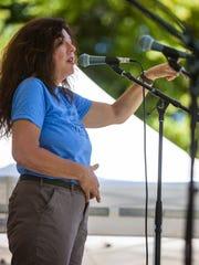 Lisa Cretsinger speaks during the Tim Cretsinger Memorial Concert at Main Street Park, Saturday, June 25, 2016