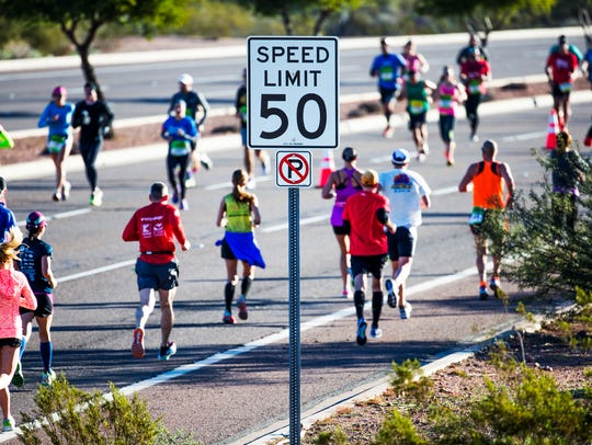 Runners make their way through Papago Park on McDowell