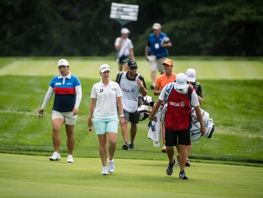 Karrie Webb, center, walks down the 17th fairway with her group including Shanshan Feng, left, during the first round of the U.S. Women's Open Championship at Lancaster Country Club on Thursday, July 9, 2015. Jeff Lautenberger Ñ For The Daily Record/Sunday News