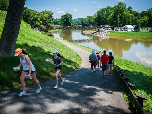 Spectators make the long walk up a winding path that bridges the gap between the 3rd hole over the Conestoga River during the second round of the U.S. Women's Open Championship at Lancaster Country Club on Friday, July 10, 2015. Jeff Lautenberger Ñ For The Daily Record/Sunday News