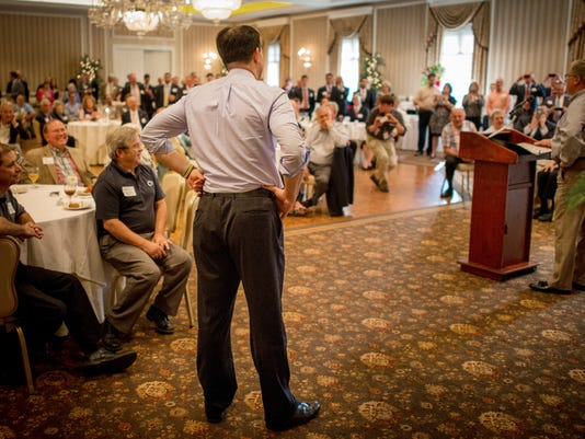 Republican presidential candidate and Wisconsin Gov. Scott Walker, left, listens as Pennsylvania State Sen. Scott Wagner, right, introduces him at the Country Club of York on Tuesday, July 28, 2015. Jeff Lautenberger Ñ For The Daily Record/Sunday News