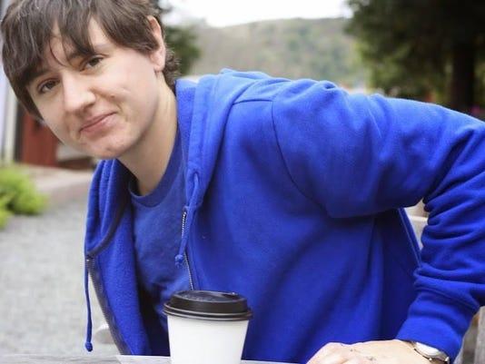 LEDE PHOTO laura in bright blue sweatshirt