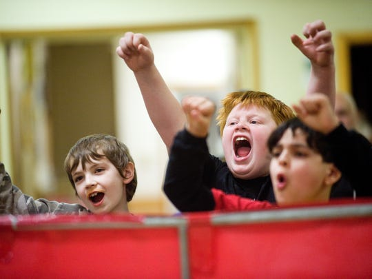 Young fans cheer for their favorite wrestlers during one of Slam All-Star Wrestling's monthly shows at the Moose Lodge in St. Albans in 2011.