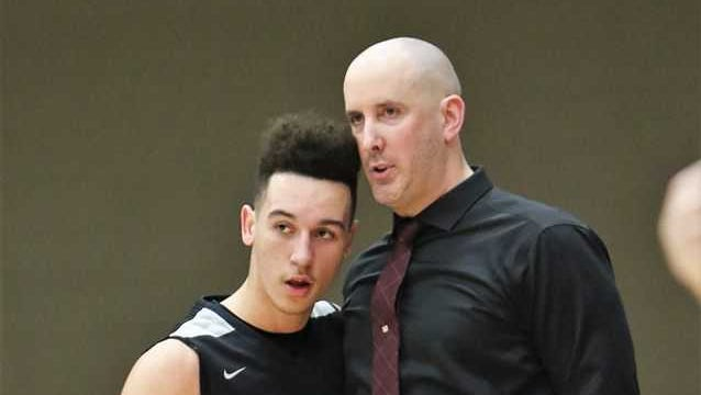 Westosha Central coach James Hyllberg provides instructions to Jaeden Zackery during a game this season.