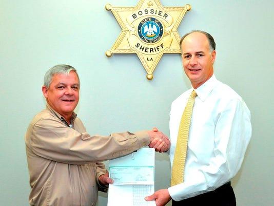 635925206463131382-DA-Presents-Check-to-BPSO---Courtesy-of-Allen-Smith-Bossier-Sheriff-s-Office.JPG