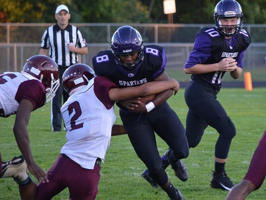 Lakeview's Jalen Watkins is tackled by a Kalamazoo