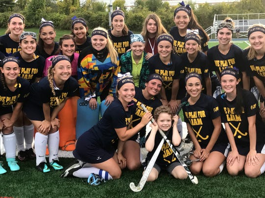 Liam Craane and the rest of the John Jay field hockey team prior to game against Roy C. Ketcham at John Jay High School in Wiccopee on Wednesday. Liam Craane is a 6-year-old battling cancer, whom the John Jay team adopted as a teammate last year.