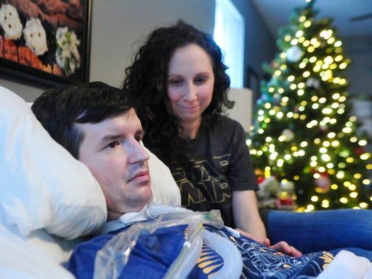 Kathleen Ashley watches as her husband, Nathan Ashley,