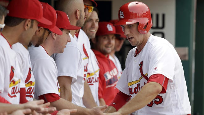 The Cardinals' Stephen Piscotty is congratulated by teammates after hitting a three-run home run during the sixth inning against the Pittsburgh Pirates on Thursday in St. Louis.