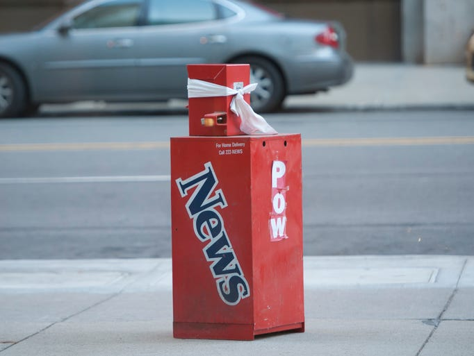 A Detroit News newspaper box was left by someone outside