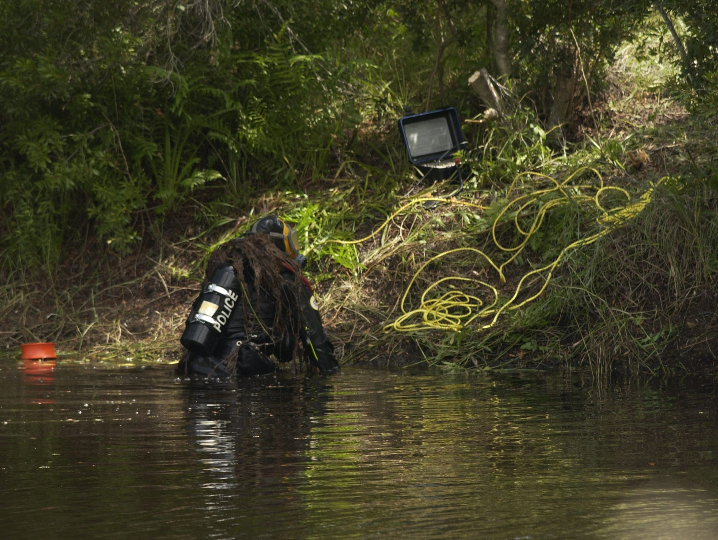 Palm Bay Police Department dive team searches a Treeland