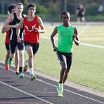 West Salem's Ahmed Muhumed leads the field in the boys varsity 800 meter run during a dual meet at North Salem on Wednesday.