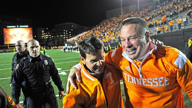 Butch Jones, right, and UT athletics director Dave Hart
