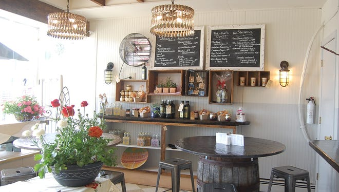 """Sidecar at The Tavern is the kind of place you can pick up fresh tomatoes, as well as get """"a quart of tomato soup, and a tomato and ricotta toast."""" It's also the perfect place to pick up a hostess gift, """"like a potted rosemary plant and a bottle of olive oil."""""""