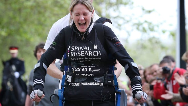 Claire Lomas crosses the finishing line after walking the 2012 London Marathon on a ReWalk exoskeleton device. The FDA on Thursday approved the device for sale in the United States.