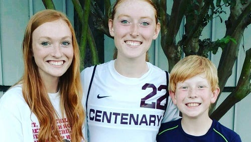 Kati-Jayde Cunningham (center) poses with sister, Kynli, and brother, Kohl. The former Times soccer honoree will suit-up for LSUS  this fall.