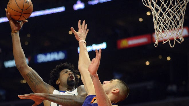 October 31, 2016; Los Angeles, CA, USA;  Clippers center DeAndre Jordan (6) moves to the basket against the defense of Suns center Alex Len (21) during the first half at Staples Center.